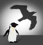 Penguin with eagle shadow. Concept graphic Royalty Free Stock Images