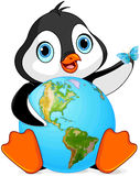 Penguin Earth Day. Penguin holds the Earth at Earth Day Stock Photography