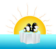 Penguin endanger. Penguins live on tiny iceberg floating in the ocean under the hot sun ray Stock Photos