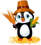 Penguin farmer. Holds corn and wheat Royalty Free Stock Photography