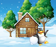 A penguin in front of the wooden house Royalty Free Stock Images
