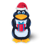 Penguin with gift box and red hat Royalty Free Stock Images