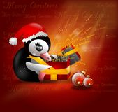 Penguin with gift Royalty Free Stock Image