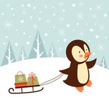 Penguin with gifts Royalty Free Stock Image