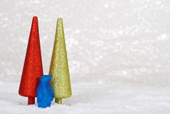 Penguin with glitter christmas trees Stock Image