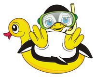 Penguin in green mask with snorkel lying top on the inflated duck. Penguin boy diver sitting on the yellow inflated duck Royalty Free Stock Photo
