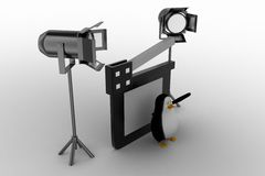 Penguin With Movie clapper And Studio Light Stock Images