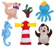 Penguin, octopus, seahorse, sea calf and lighthouse Stock Photo