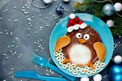 Penguin pancake - funny idea for kids. Christmas breakfast stock image