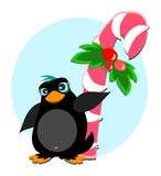 Penguin with Peppermint Sugar Cane Royalty Free Stock Image