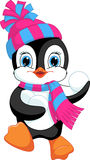Penguin playing snowballs Stock Images