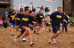 Penguin Plunge. A group of volunteers from the Hartford Police Department brave icy waters to raise money for the Special Olympics at a Penguin Plunge event royalty free stock image
