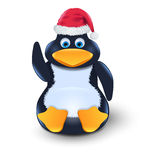 Penguin with red hat sitting on a floor Royalty Free Stock Photo
