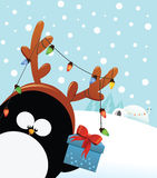 Penguin With Reindeer Costume Royalty Free Stock Photography