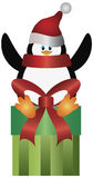 Penguin with Santa Hat on Present Illustration Stock Images