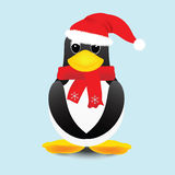 Penguin. In santa hat with a scarf around his neck Stock Images