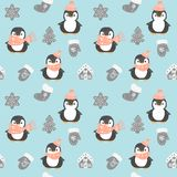 Penguin seamless pattern. Cute penguins in red Christmas hat and scarf isolated on blue background with diffrent christmas decorat stock illustration