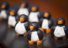Penguin-shaped olive cheese appetizers. Olive, cheese, carrot appetizers made in the shape of penguins Royalty Free Stock Photography