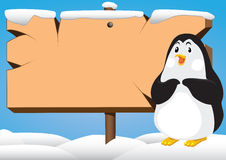 Penguin and signboard  Stock Photography