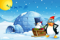 A penguin and the sleigh with a snowman near the igloo Royalty Free Stock Photo
