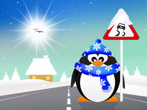 Penguin with slippery road sign Royalty Free Stock Photography