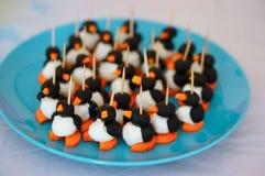 Penguin snack Stock Photo