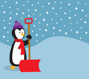 Penguin With Snow Shovel Royalty Free Stock Photos
