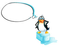 A penguin standing above an icecube Royalty Free Stock Image