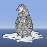 Penguin stands on an ice floe. Zen tangle vector. Zentangle animals of the Antarctic. Blue sky and ocean. Stock Photo