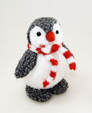 Penguin toy in scarf. Funny penguin toy in red and white scarf Royalty Free Stock Photos