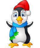 Penguin waving hand wearing red cap Stock Photos