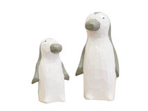Penguin wooden dolls isolated on white background. Clipping path Royalty Free Stock Photo