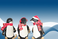 Penguins. Christmas penguins on a winter background Royalty Free Stock Photography