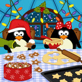 Penguins bake Christmas cookies Royalty Free Stock Images