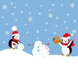 Penguins build a snowman. Penguins and rabbit build a snowman. Vector illustration Royalty Free Stock Photo
