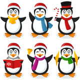 Penguins Cartoon Christmas Set. Collection of six funny cartoon Christmas penguin characters in different positions and expressions, isolated on white background Stock Photo