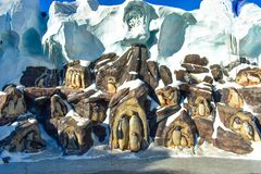 Penguins carved in stone at Seaworld in International Drive area . stock image