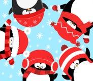 Penguins Celebrating Christmas. Cute little penguins celebrating christmas in a snowy weather Stock Images