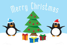 Penguins Celebrating Christmas Decorating a Christmas Tree Stock Image