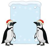Penguins with Christmas poster Royalty Free Stock Images