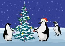 Penguins and Christmas tree. Antarctic emperor penguins decorate the Christmas tree Royalty Free Stock Photography