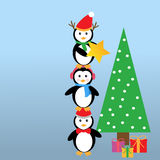 Penguins and Christmas tree Royalty Free Stock Image