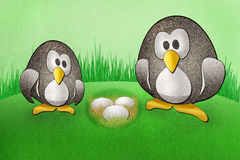 Penguins with  eggs recycled paper craft Royalty Free Stock Image
