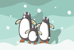Penguins Family. Watching snow together Stock Images