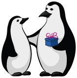 Penguins with a gift box Royalty Free Stock Images