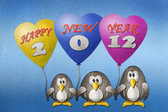 Penguins happy new year 2012. Recycled paper craft on paper background Royalty Free Stock Photos