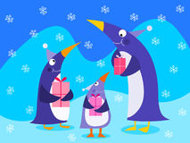Penguins holding gifts Royalty Free Stock Photography