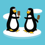 Penguins with ice lolly Stock Photography