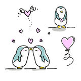 Penguins kissing couple Royalty Free Stock Photos