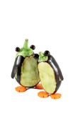 Penguins made from aubergines Stock Photo